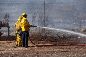4:35 PM - Firefighters douse hot spots in the Foothill Blvd parkway. Nancy Hamlett.