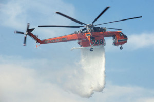4:47 PM - A Sikorksy Skycrane S-64 helicopter equipped with Erickson Air-Crane's proprietary 2,650-gallon detachable water tank releases a load of water over the BFS. Nancy Hamlett.
