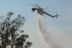 4:45 PM - A Sikorsky Skycrane helitanker drops another load of water. Nancy Hamlett.