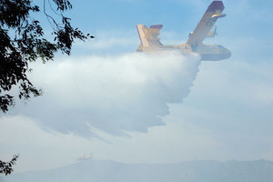 4:49 PM - A Canadair Super Scooper dumps a load of water on the fire.  Nancy Hamlett.