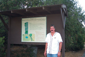 BFS Director Gene Fowler with the first version of the entry sign, September 2001. Nancy Hamlett.