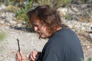 Kerry Knudsen examines a lichen specimen