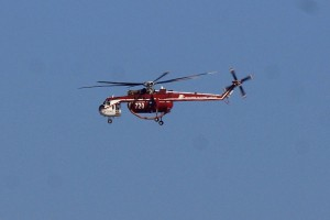 Day 25, September 19 - a water-dropping heli-tanker flies over the BFS on the way to the Station Fire.