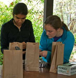 Megan Wheeler (right) helps volunteer Thendral Govindraj (HMC '16) sort one of her many litter samples for carbon analysis.