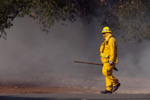 4:40 PM - A firefighter checks the Foothill Blvd parkway for hot spots. Nancy Hamlett.