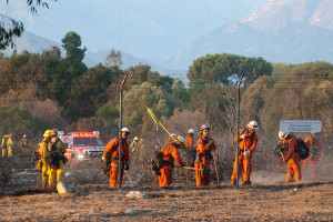 6:48 PM - Fire crews work to put out hot spots in the East Field. Nancy Hamlett.