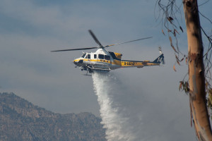 4:36 PM - A Bell 412 water-dropping helicopter drops its load on the BFS. Nancy Hamlett.