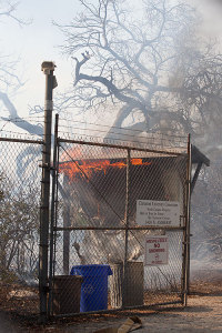 The kiosk burning in the Foothill Fire, September 11, 2013. Steven Felschundneff. Used with permission of the Claremont Courier.