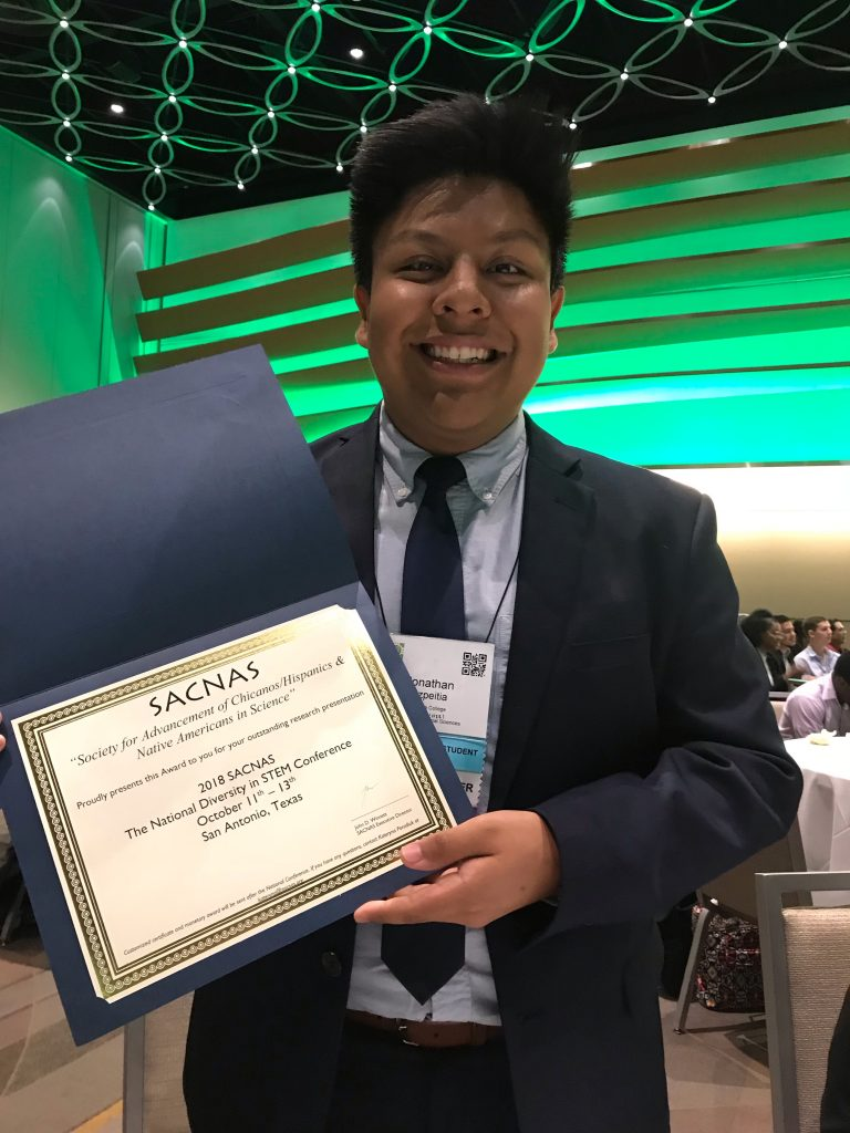 Jovani receives the 2018 SACNAS Undergraduate Student Poster Presentation Award in General Psychology