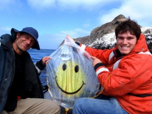 Daryl and Augie cleaning up the ocean one balloon at a time